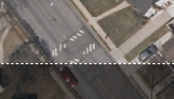 A screenshot of an aerial image of a faded speed bump in a residential New York neighborhood.