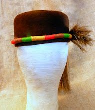 Photo: <KAPELUXE> Unique-Chique Hats by Luba Bilash ART & ADORNMENT  Chocolate brown wool felt; horse mane hair; embroidery thread; 360 degree possibilities. Can also be worn on an angle. Size S - 52 cm/20.5 in. SOLD