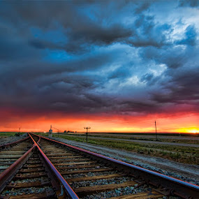 Where the road meets the sun by Mike Ritchie - Landscapes Sunsets & Sunrises ( clouds, art, tracks, sun, sky, red, color, blue, sunset, summer, night, nikon, light )