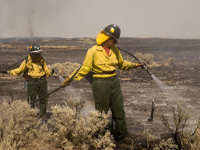 Photo: West Cinder Prescribed Burn, Twin Falls District BLM, Idaho, August 4, 2010, female firefighters, using water, hose, Forester nozzle