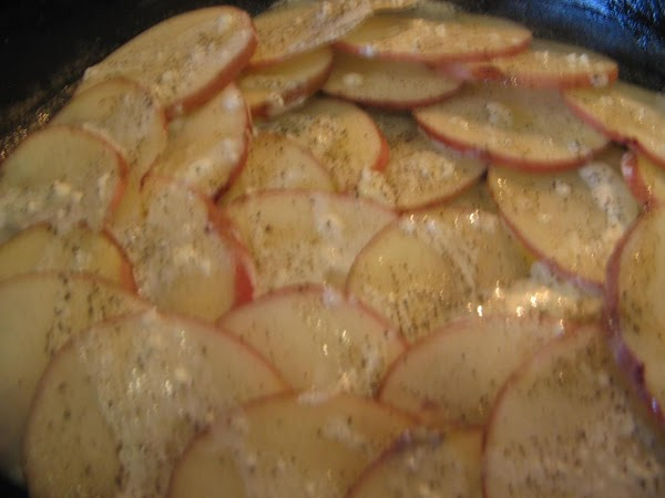 Lay the potato slices on a paper-towel lined baking sheet to air dry.In a...