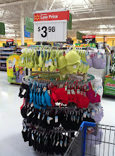 Photo: Heading to the food section for my little party I saw this display of bras for under $4! WOOHOO!