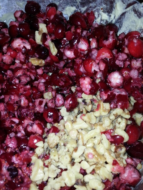 Add beaten egg, nuts and cranberries to mixture.  Mix well.