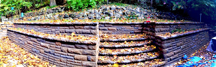 Photo: A panorama shot of the same wall. The steps lead up and to the side to get to the upper area. Built of Permacon Lafayette cast stone.