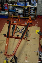 Photo: chassis in etch primer with the felt strips cut ready to be soaked in Ensis fluid