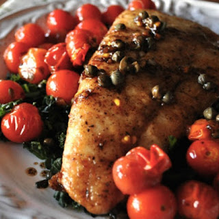 Seared Halibut with Cherry Tomatoes and Caper Pan Sauce.