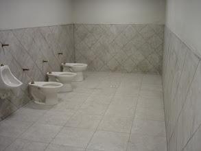 Photo: commercial bathroom job installation tiled wall& floor