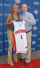 Photo: CLARKSTON, MI - AUGUST 12: Sheryl Crow (L) poses with Detroit Pistons head coach Lawrence Frank at the Palace Sports and Entertainment's Come Together Celebration concert at the DTE Energy Music Theater on August 12, 2012 in Clarkston, Michigan. (Photo by Paul Warner/Getty Images)