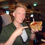 enjoying my currywurst at Belfast Love in Toronto in Toronto, Ontario, Canada