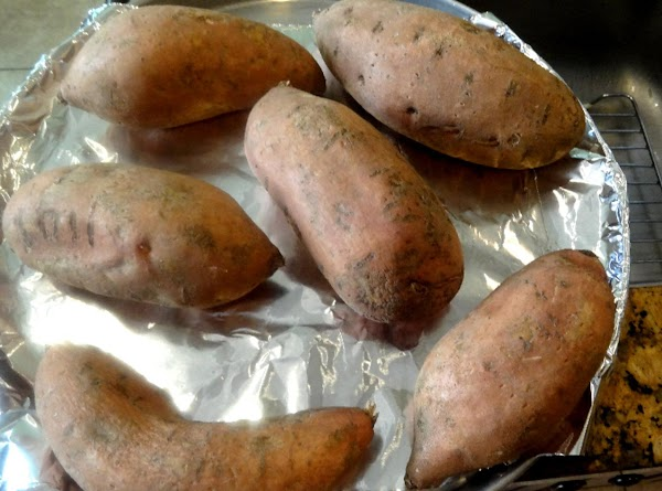 Bake the sweet potatoes on a cookie sheet on foil.  Pierce the skins...
