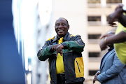 ANC President Cyril Ramaphosa addressing members gathered in the street outside Luthuli House, where the party leadership thanked supporters for voting for them.