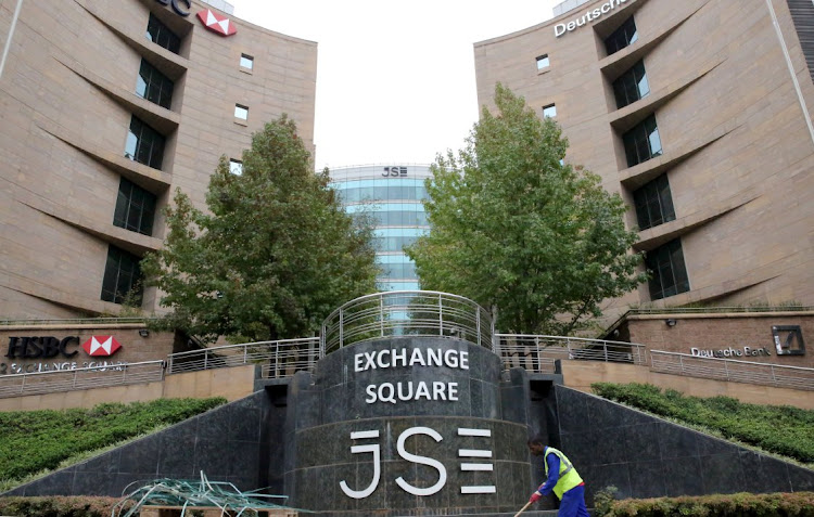 FILE PHOTO: A worker sweeps in front of the Johannesburg Stock Exchange (JSE), in Johannesburg, South Africa, March 23, 2016. Picture: REUTERS / PHILIMON BULAWAYO