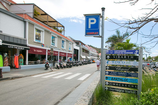 st-barts-signs.jpg - Signs pointing to key properties on the main street of Gustavia, St. Barts.