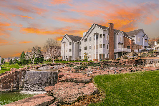 The Mansions at Hockanum Crossing apartment building with fountain at dusk