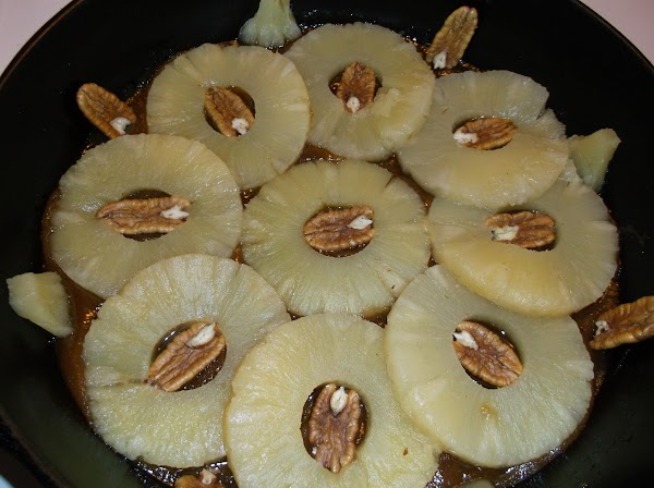 Place a pecan half in center of each ring, pressing lightly into melted sugar....