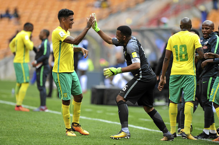 CHEERS Bafana Bafana stand-in captain Itumeleng Khune celebrates with Clayton Daniels after South Africa beat Burkina Faso 3-1 in their must-win Fifa 2018 World Cup qualifier match at FNB Stadium, in Soweto, on SaturdayPicture: Gallo Images