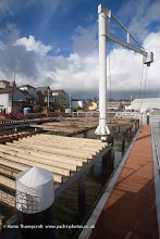 Photo: The first section of joists reached the end of the apron adjacent to the marina on 12 Feb 2014