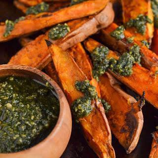 Baked Sweet Potato Wedges with Vegan Parsley Pesto.