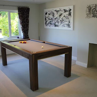 the refined pool table on a carpet in front of a windo