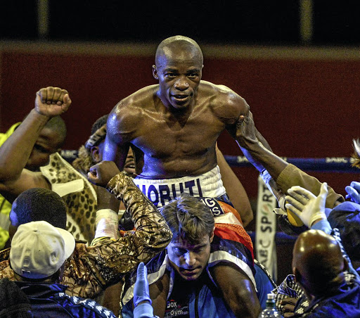 Riding high: Moruti Mthalane celebrates beating Genisis Libranza in Johannesburg in April 2017. Picture: GALLO IMAGES