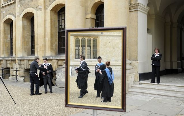 Graduates after a graduation ceremony at Oxford University. Universities boost regional economies, researchers have found. Picture: REUTERS/PAUL HACKETT