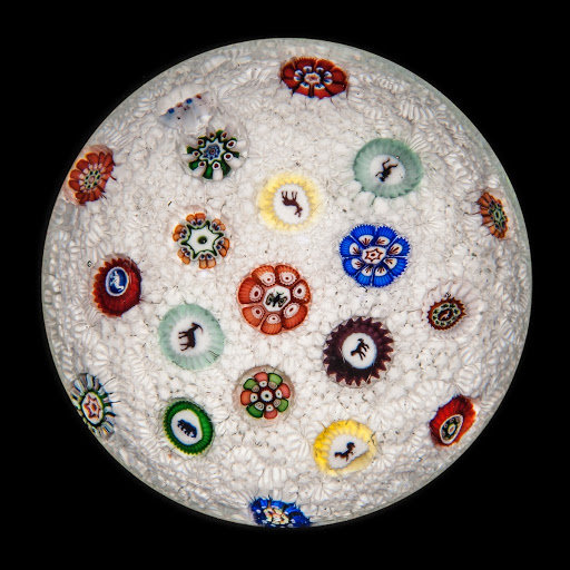 Spaced Millefiori with Silhouette Canes on Stardust Carpet Ground Paperweight