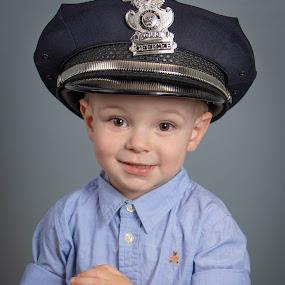 Sweetie by Dan Bartlett - Babies & Children Child Portraits ( police, hat, hope, portrait, boy, child )