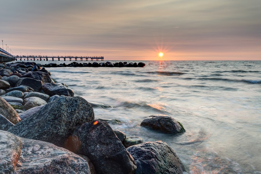 Sunset by Baltic Sea by Norbert Durko - Landscapes Sunsets & Sunrises ( water, hdr, beautiful, creamy, baltic sea, manual blending, palanga, sunset, movement, long exposure, bridge, lithuania, stones, rocks )
