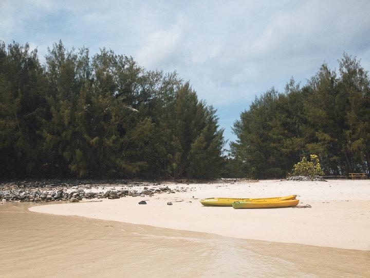 Kayaks on a motu beach in Rarotonga.