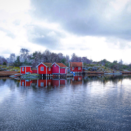 Coold day at the beach in Önnered Sweden by Eva Larsson - Landscapes Waterscapes ( clouds reflection fishing village önnered sweden red houses )