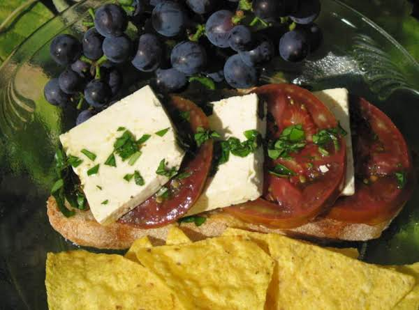 Caprese Sandwich Served Up With Corn Chips And Fresh Grapes From The Back Garden Arbor!  Enjoy It Al Fresco!