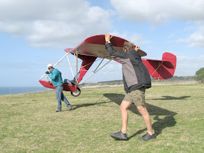 Photo: Ground handling of the Goat1 in high winds can be just a matter of flying the glider with one hand while walking to the launch.   Floyd Fronius is the pilot, at Torrey Pines Gliderport, San Diego, California, December 2009