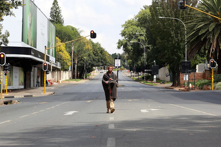 A man walks in empty streets in Sandton, Johannesburg on the first day of the 21-day lockdown.