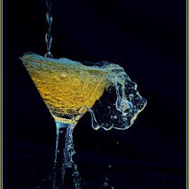 Shaken, not stirred by Debi Baskind Jahier - Abstract Water Drops & Splashes ( liquid, splash, blue, drop, martini, pour, glass, spill, stem, yellow, liquor,  )