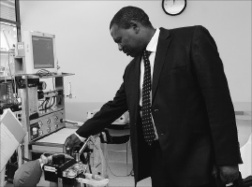 EXPLORING: KwaZulu-Natal premier Zweli Mkhize inspects intensive care unit equipment at Southbank Institute of Technology during his official visit to Queensland, Australia, yesterday.Pic: SIYABONGA MOSUNKUTU. 24/03/2010. © Sowetan.