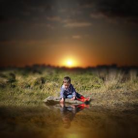 Water Boy by Una Williams Photos - Babies & Children Children Candids ( child, water, grasses, sunset, rock, boy )