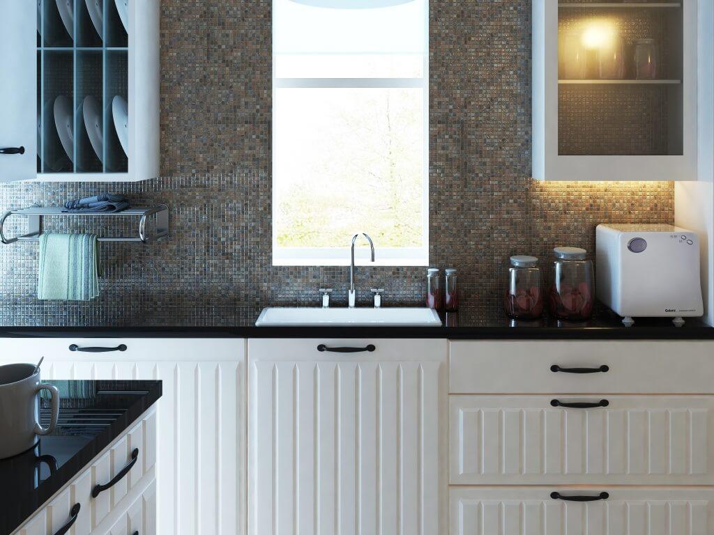 Kitchen backsplash with tiny mosaic tile grid in dark neutrals