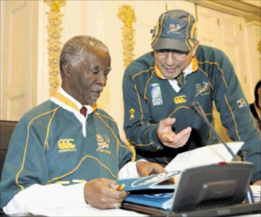 President Thabo Mbeki and Minister of Finance Trevor Manuel show their support for the Springboks during the World Cup in October 2007