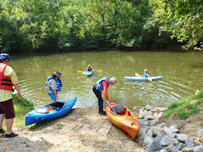 Photo: Stephanie in the river with Ivy. Dusty & Carl getting ready to put in while Nicole watches.