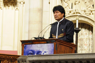 Photo: Evo Morales prays for Hugo Chávez at Riverside Church in New York City.