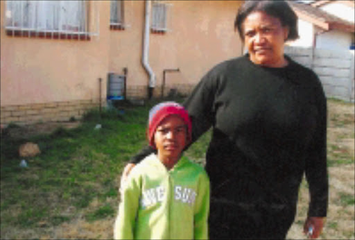 BROKEN PROMISES: Mine widow Masabata Nqandela with her youngest son Thami. 08/11/08. © Unknown.