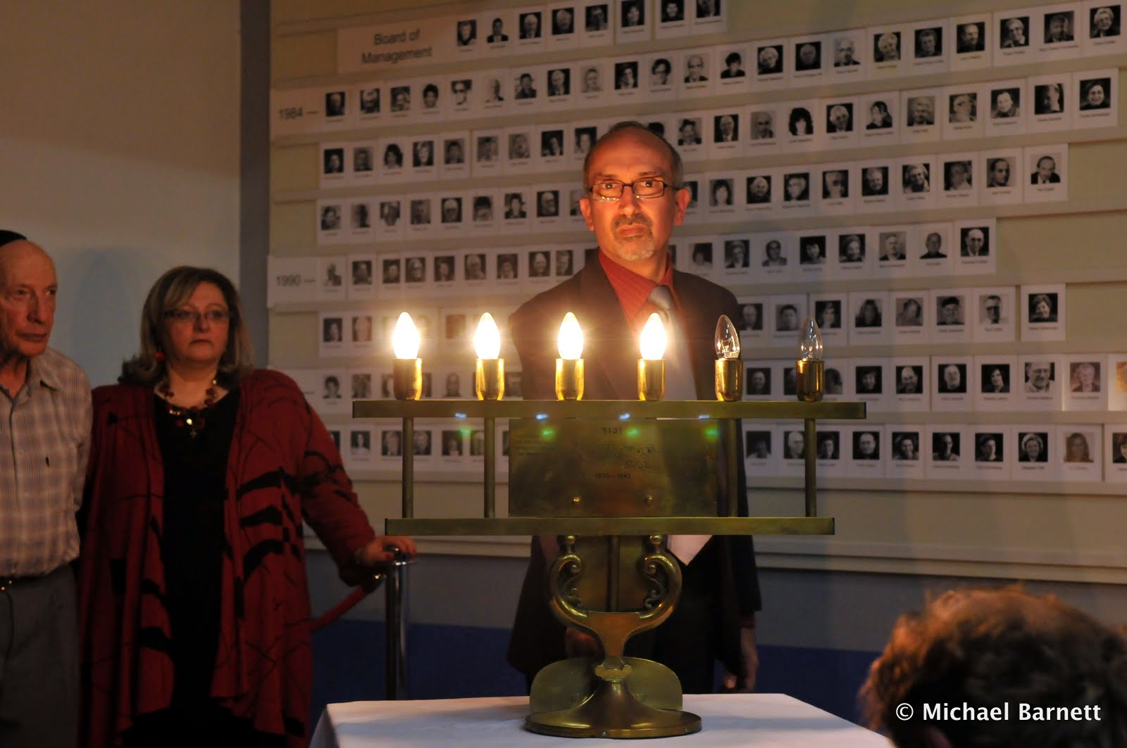 Colin Krycer lights a candle in memory of the homosexual victims of the Holocaust