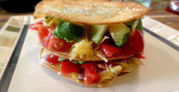 Add the third corn tortilla to the top to finish the Quesadilla Stack. ...