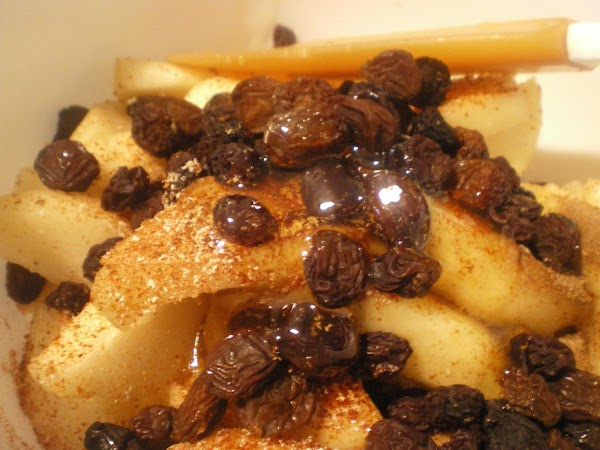 Into a medium mixing bowl add peeled, cored, and thick sliced pears. Add raisins and...