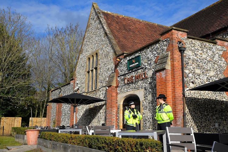 Police officers stand outside a pub near to where former Russian intelligence officer Sergei Skripal, and his daughter Yulia were found unconscious after they had been exposed to an unknown substance, in Salisbury, Britain. Picture: REUTERS/TOBY MELVILLE
