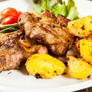 Pork Steak with Seasoned Potatoes.