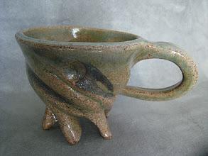 Photo: twisted footed mug with clear iron glaze