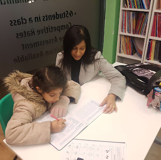 tutor assisting young student with homework