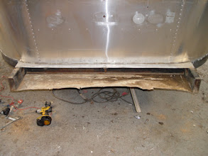 Photo: The trunk area before removing the old pan
