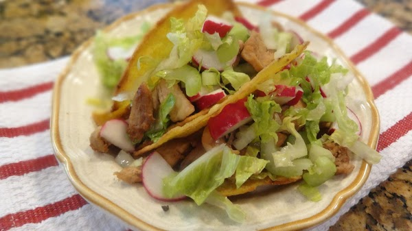 Fill each taco shell with the cooked chicken, top with a generous helping of...